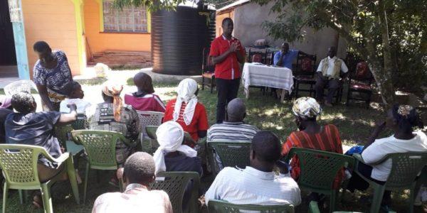 Sensitizing community members on sanitation marketing at Naya.