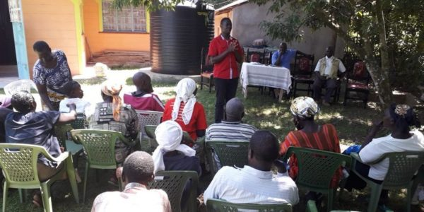 Sensitizing community members on sanitation marketing at Naya.